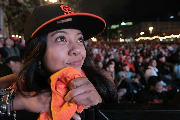 May Calceta watching the World Series along with other Giants fans at Civic Center Plaza in San Francisco on Sunday, Oct. 28, 2012. Photo: Mathew Sumner, Special To The Chronicle