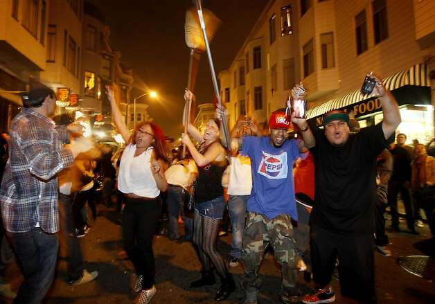 Fans on Grant Avenue took to the street to celebrate. Giants fans in North Beach went wild as their baseball team won their second World Series title in three years Sunday October 28, 2012. Photo: Brant Ward, The Chronicle