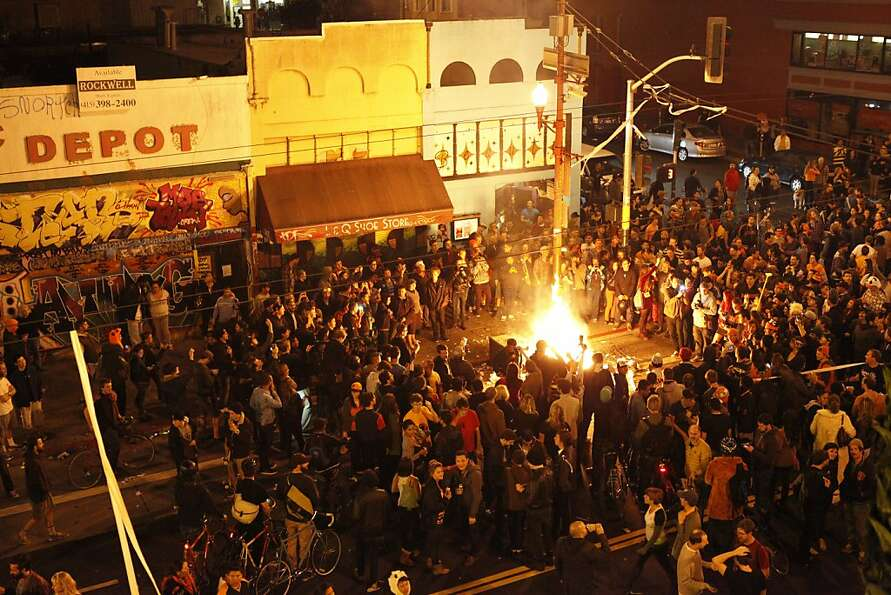 People party at the intersection of Mission and 19th Streets in San Francisco Calif. celebrating the