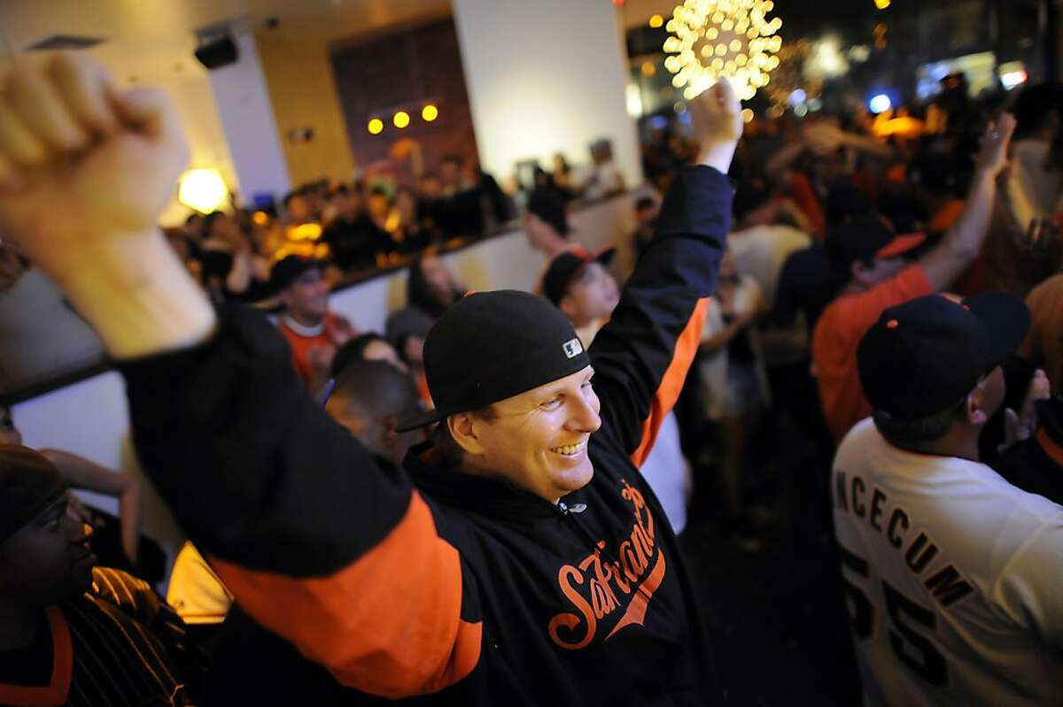 Michael Heffernan of San Francisco cheers on the Giants as he watches th game at Lucky Strike Lanes near AT&T park in San Francisco, Sunday October 28th, 2012.