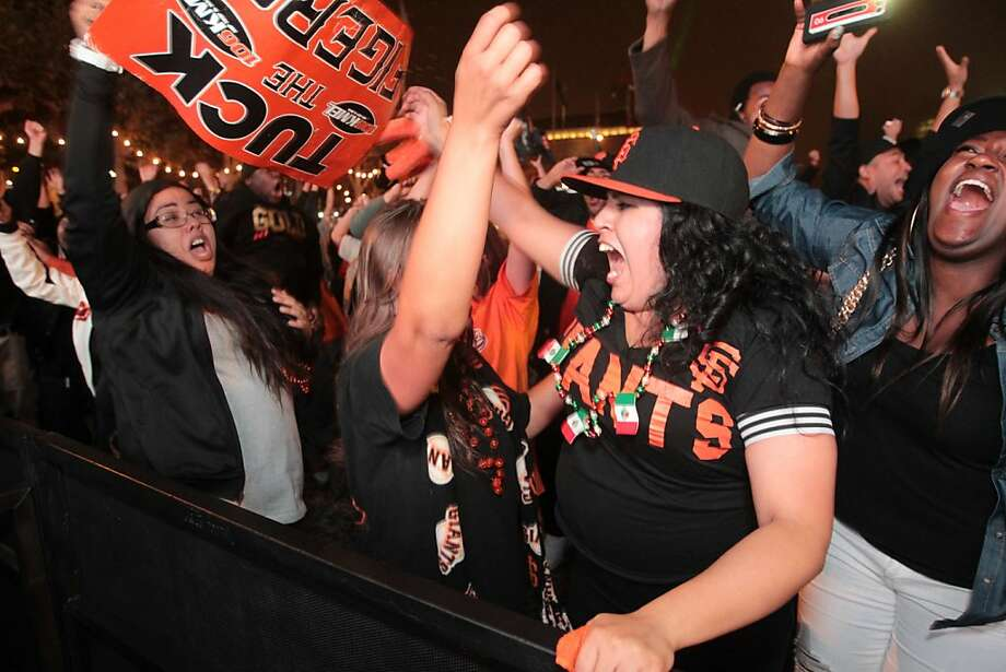 Karina Jones, center right, along with other Giants fans celebrate in San Francisco their team winning the World Series on Sunday, Oct. 28, 2012. Photo: Mathew Sumner, Special To The Chronicle