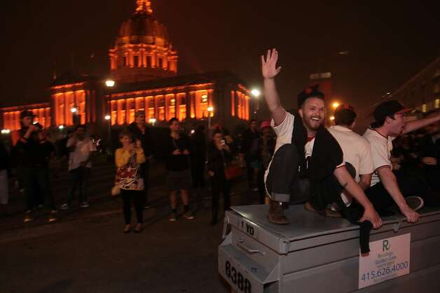 Giants fans revel in the streets in San Francisco after the Giants won the World Series on Sunday, Oct. 28, 2012. Photo: Mathew Sumner, Special To The Chronicle