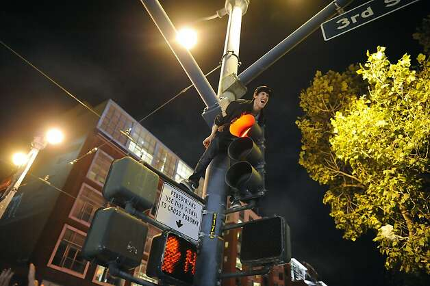 Fans celebrate the San Francisco Giants winning the 2012 World Series outside of AT&T park in San Francisco, Sunday October 28th, 2012. Photo: Michael Short, Special To The Chronicle