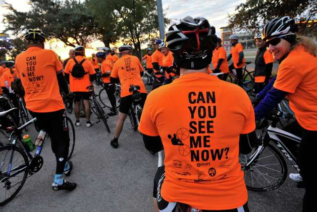 More than 300 bicyclists move along the I-10 access road during a ride on Oct. 28, 2012,  to benefit Monica Caban. Caban was struck and severely injured by a car while training on her bike for a triathalon. Photo: Robin Jerstad/For The Express-Ne