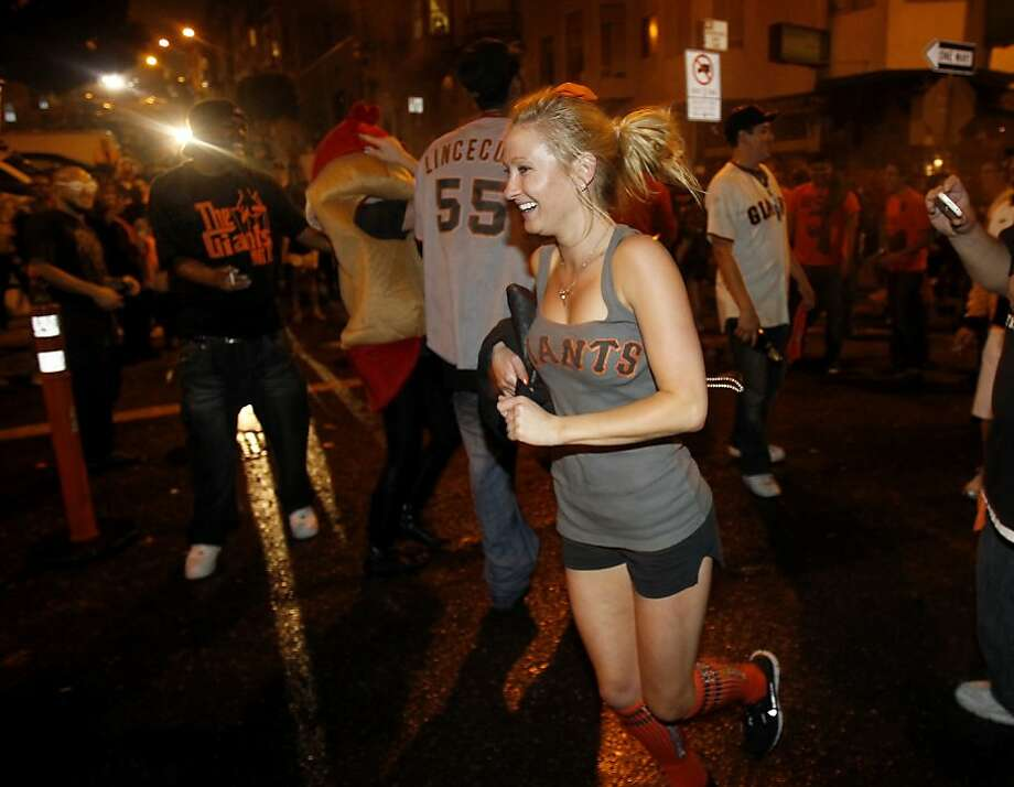Everyone was running through the street after the victory. Giants fans in North Beach went wild as their baseball team won their second World Series title in three years Sunday October 28, 2012. Photo: Brant Ward, The Chronicle
