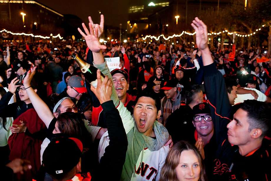 Giants fans celebrate at Civic Center at a World Series viewing party at Civic Center in San Francisco, Calif., Sunday, October 28, 2012. Photo: Jason Henry, Special To The Chronicle