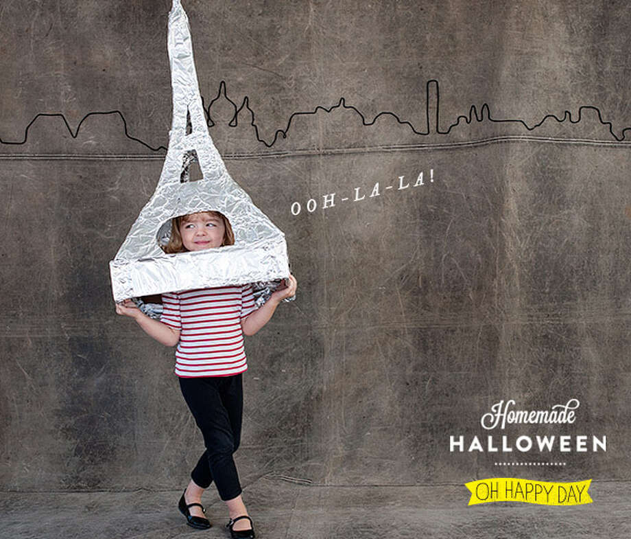 Oh la la la! This Parisian costume is fabulous! The main thing you need to make the Eiffel Tower costume is a big roll of aluminum foil. (Oh Happy Day! / Sarah Hebenstreit )