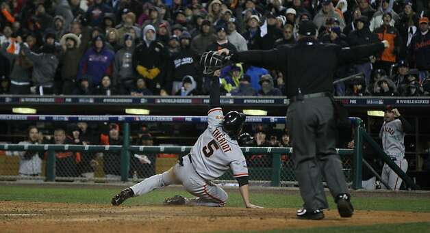 Giants' 2nd baseman Ryan Theriot celebrates after scoring the go ahead run off a Marco Scutaro single in the 10th inning during game 4 of the World Series at Comerica Park on Sunday, Oct. 28, 2012 in Detroit, MI. Photo: Lance Iversen, The Chronicle