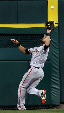 San Francisco Giants Angel Pagan catches Detroit Tigers Jhonny Peralta deep fly ball in the 9th inning during game four of the World Series at Comerica Park in Detroit, Mi., Sunday, Oct. 28, 2012. Photo: Lance Iversen, The Chronicle
