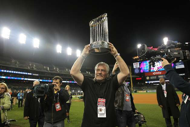 Giants general manager Brian Sabean holds the championship trophy after San Francisco won its second World Series in three years last Sunday. Photo: Lance Iversen, The Chronicle