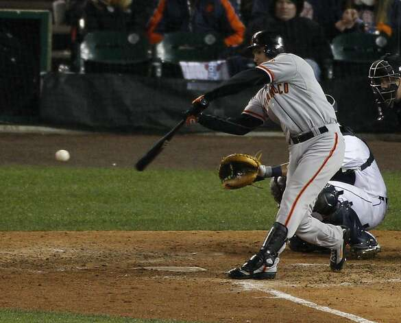 Giants' 2nd baseman Ryan Theriot singles in the 10th inning during the World Series game 4 at Comerica Park in Detroit, MI, on Sunday, Oct. 28, 2012. Photo: Carlos Avila Gonzalez, The Chronicle