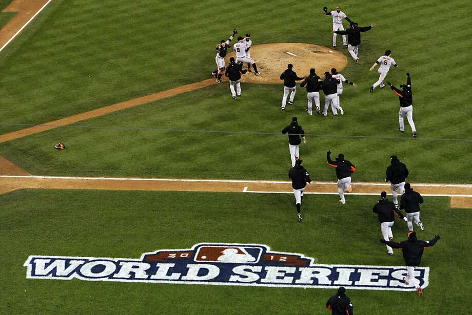 The San Francisco Giants run to celebrate on the field after they defeated the Detroit Tigers in Game 4 of the World Series on Sunday, October 27, 2012, in Detroit, Mi. The Giants are the 2012 World Champions after sweeping the Tigers. Photo: Carlos Avila Gonzalez, The Chronicle