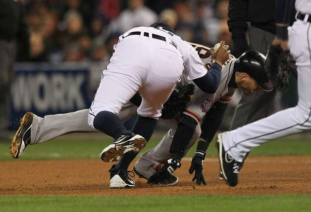 Giants' 2nd baseman Marco Scutaro is caught in a rundown by Tigers' pitcher Octavio Dotel in the 8th inning during game 4 of the World Series at Comerica Park on Sunday, Oct. 28, 2012 in Detroit, MI. Photo: Lance Iversen, The Chronicle