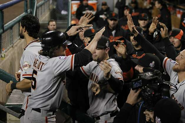 Giants' DH Ryan Theriot is greeted in the dugout after scoring in the 10th inning during game 4 of the World Series at Comerica Park on Sunday, Oct. 28, 2012 in Detroit, MI. Photo: Michael Macor, The Chronicle