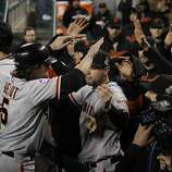 Giants' DH Ryan Theriot is greeted in the dugout after scoring in the 10th inning during game 4 of the World Series at Comerica Park on Sunday, Oct. 28, 2012 in Detroit, MI.