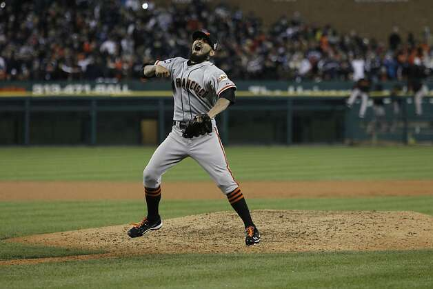 Giants' pitcher Sergio Romo celebrates his 10th inning strike out against Miguel Cabrera to win the World Series during game 4 of the World Series at Comerica Park on Sunday, Oct. 28, 2012 in Detroit, MI. Photo: Michael Macor, The Chronicle
