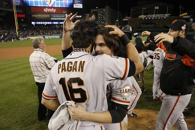 Angel Pagan and Ryan Theriot celebrate their World Series win at Comerica Park on Sunday, Oct. 28, 2012 in Detroit, MI. Photo: Michael Macor, The Chronicle