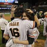 Angel Pagan and Ryan Theriot celebrate their World Series win at Comerica Park on Sunday, Oct. 28, 2012 in Detroit, MI.