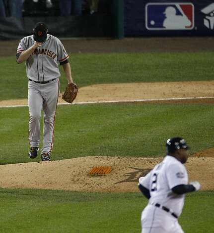 Giants' pitcher Matt Cain warms his hand as Tigers' left fielder Delmon Young rounds the bases on a solo homer in the 6th inning during the World Series game 4 at Comerica Park in Detroit, MI, on Sunday, Oct. 28, 2012. Photo: Carlos Avila Gonzalez, The Chronicle