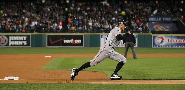 Giants' right fielder Hunter Pence passes 3rd base on the way home on a Brandon Belt triple in the 2nd inning during game 4 of the World Series at Comerica Park on Sunday, Oct. 28, 2012 in Detroit, MI. Photo: Lance Iversen, The Chronicle