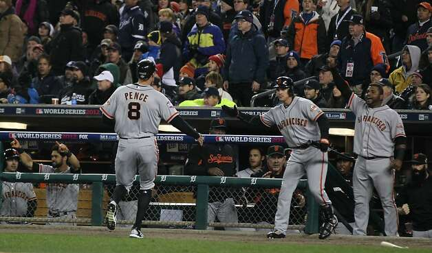Giants' right fielder Hunter Pence is greeted by Ryan Theriot and Pablo Sandoval after scoring in the 2nd inning during game 4 of the World Series at Comerica Park on Sunday, Oct. 28, 2012 in Detroit, MI. Photo: Lance Iversen, The Chronicle