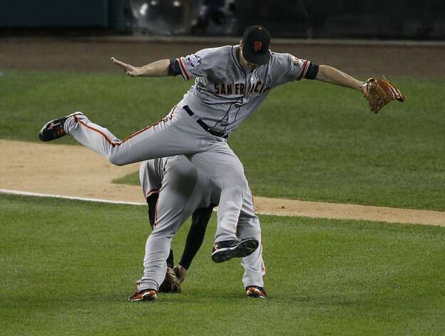 Giants' pitcher Matt Cain jumps to avoid a collision with Pablo Sandoval in the 3rd inning during the World Series game 4 at Comerica Park in Detroit, MI, on Sunday, Oct. 28, 2012. Photo: Carlos Avila Gonzalez, The Chronicle
