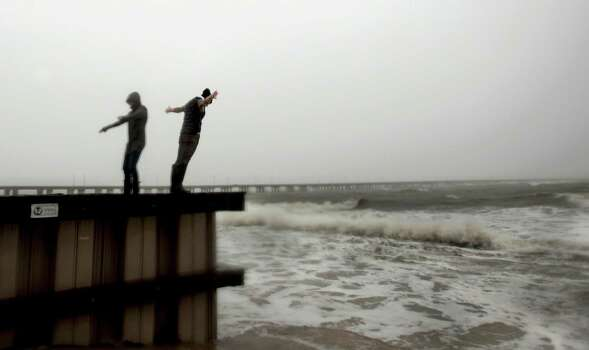 Jessica Ospina, left, and Allison Kane of Virginia Beach, Va., lean into the strong wind and rain off the Chesapeake Bay near the Chesapeake Bay Bridge tunnel in Virginia Beach, as Hurricane Sandy works its way north, battering the U.S. East Coast Sunday, Oct. 28, 2012. Photo: L. Todd Spencer, AP / The Virginian-Pilot