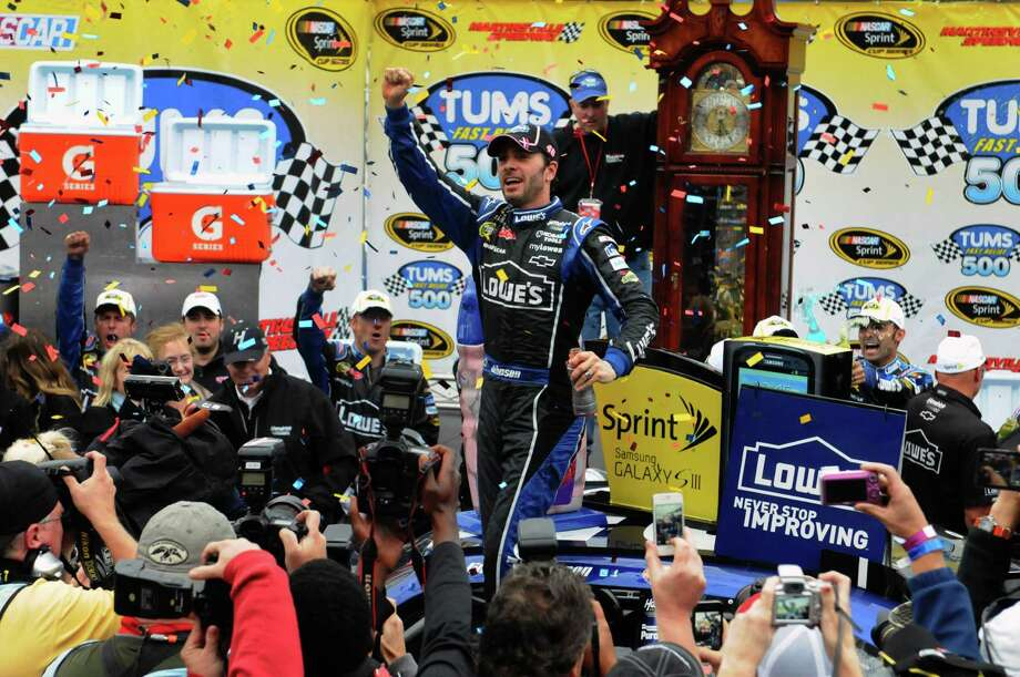 Jimmie Johnson celebrates in Victory Lane after winning the NASCAR Sprint Cup Series auto race at Martinsville Speedway, Sunday, Oct. 28, 2012, in Martinsville, Va. (AP Photo/Don Petersen) Photo: Don Petersen