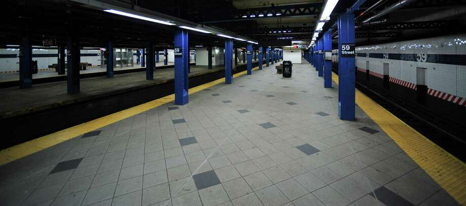 A subway platform stands deserted at Columbus Circle due to closure in New York, U.S., on Sunday, Oct. 28, 2012. The U.S. securities industry canceled equity trading on all markets on Oct. 29, moving to protect workers as Hurricane Sandy barreled toward New York City with 70-mile-per-hour winds and the threat of an 11-foot surge. Photographer: Peter Foley/Bloomberg Photo: Peter Foley, Bloomberg