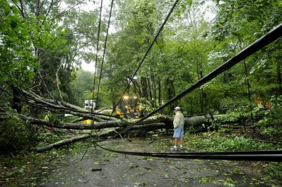 Irene knocked out power for hundreds of thousands in Connecticut. Sandy could be even worse.Crews work to clear a tree downed by Tropical Storm Irene on Sunday, Aug. 28, 2011. (AP)