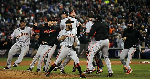 San Francisco Giants Sergio Romo center and his teammates celebrate their World Series win over the Detroit Tigers at Comerica Park in Detroit, Mi., Sunday, Oct. 28, 2012. Photo: Lance Iversen, The Chronicle