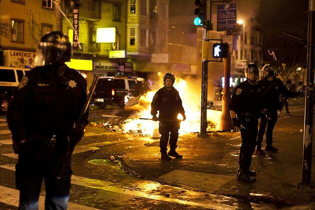 SFPD advanced up Mission street dispersing crowd so SFFD could extinguish the fires during Giants World Series celebrations in San Francisco, Calif., Sunday, October 28, 2012. Photo: Jason Henry, Special To The Chronicle