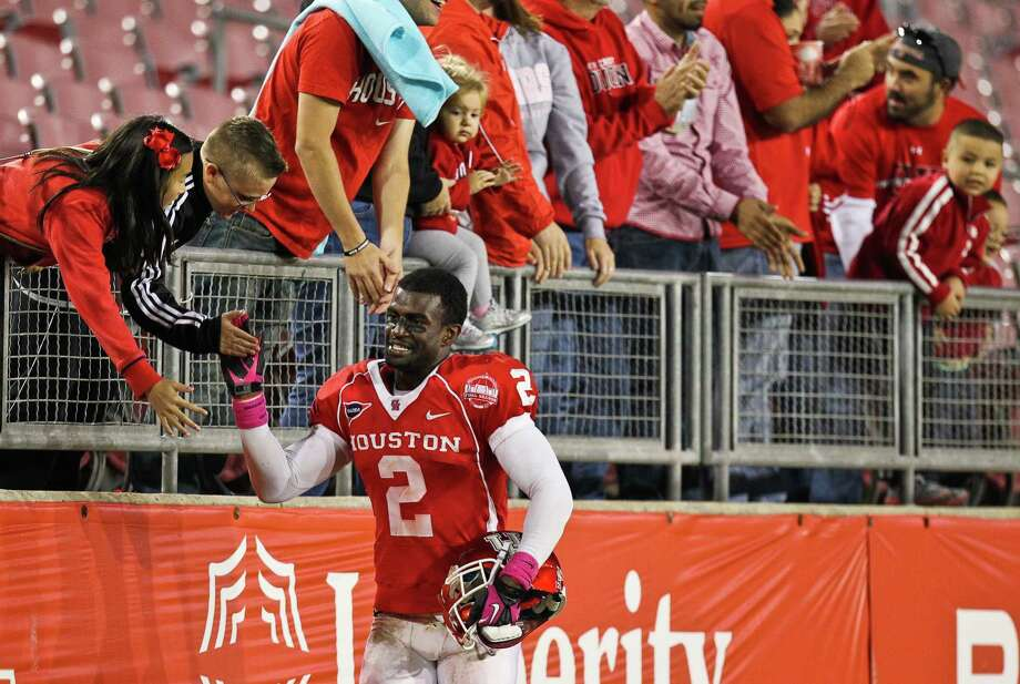 D.J. Hayden greets fans after his game against UTEP, Saturday, Oct. 27 at Robertson Stadium in Houston. The Coogs won 45-35. Photo: Nick De La Torre, Houston Chronicle / Houston Chronicle