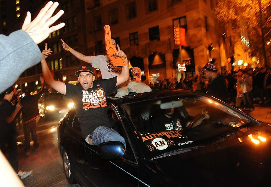 Fans celebrate in San Francisco after the Giants won the World Series on October 28, 2012. Photo: Susana Bates, Special To The Chronicle