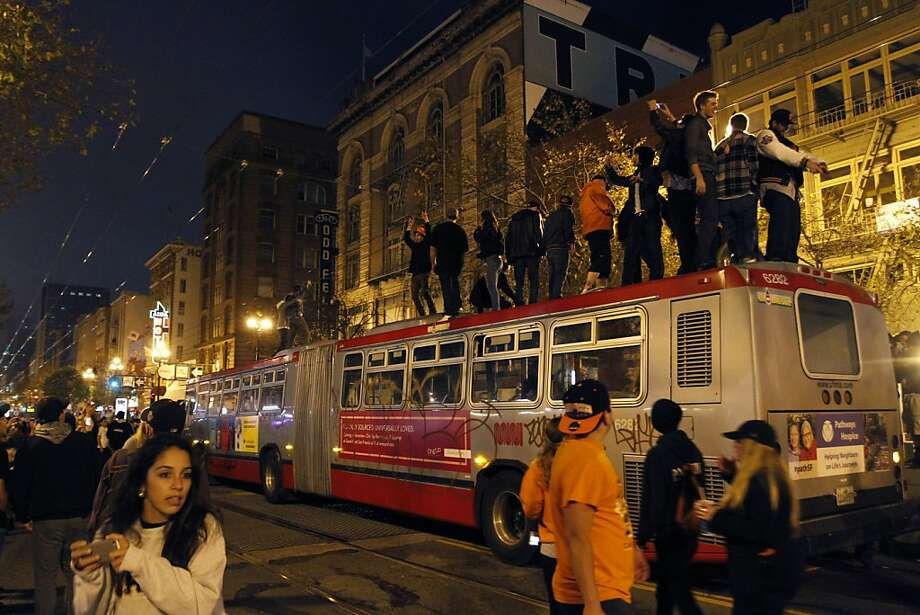 Fans celebrate on top of buses after the San Francisco Giants won the World Series on Sunday, October 28, 2012. Photo: Sean Culligan, Special To The Chronicle