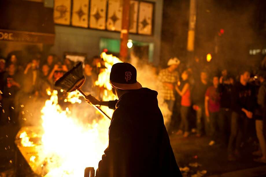 Giants fans celebrate on Mission and 19th streets in San Francisco, Calif., Sunday, October 28, 2012. Photo: Jason Henry, Special To The Chronicle