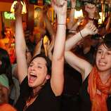 Linda Shak and Avital Ungar celebrate at Pheonix Bar in the Mission District of San Francisco Calif. as the San Francisco Giants take the lead in the top of the 10th inning as they play game four of the world series  on Sunday, Oct. 28, 2012.