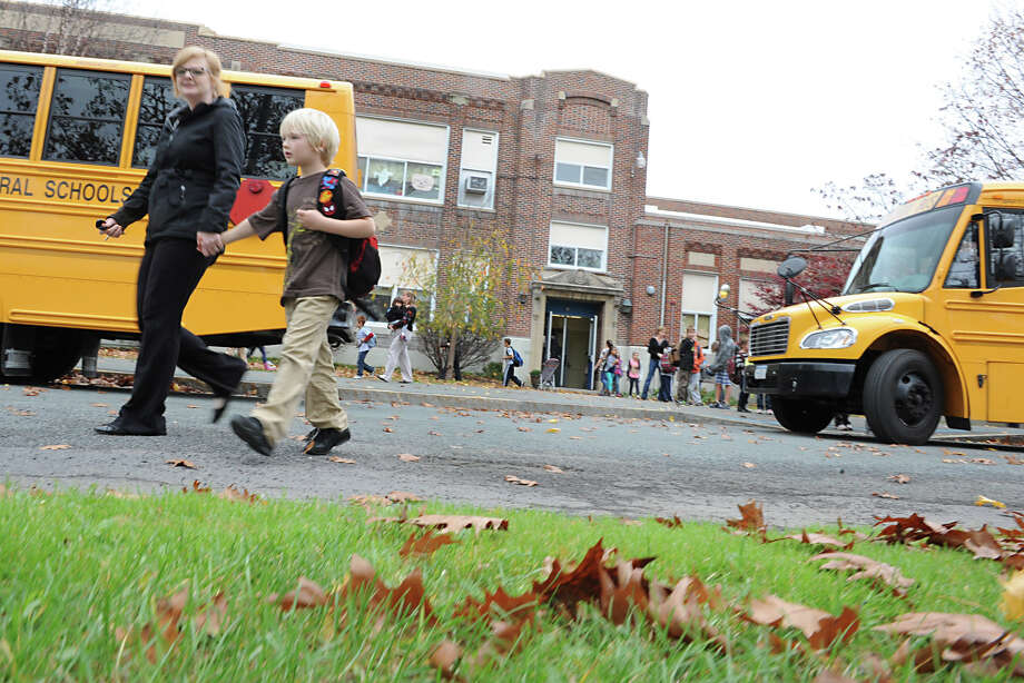 Students are let out of school early at Elsmere Elementary School due to Hurricane Sandy on Monday, Oct. 29, 2012 in Delmar, N.Y. (Lori Van Buren / Times Union) Photo: Lori Van Buren