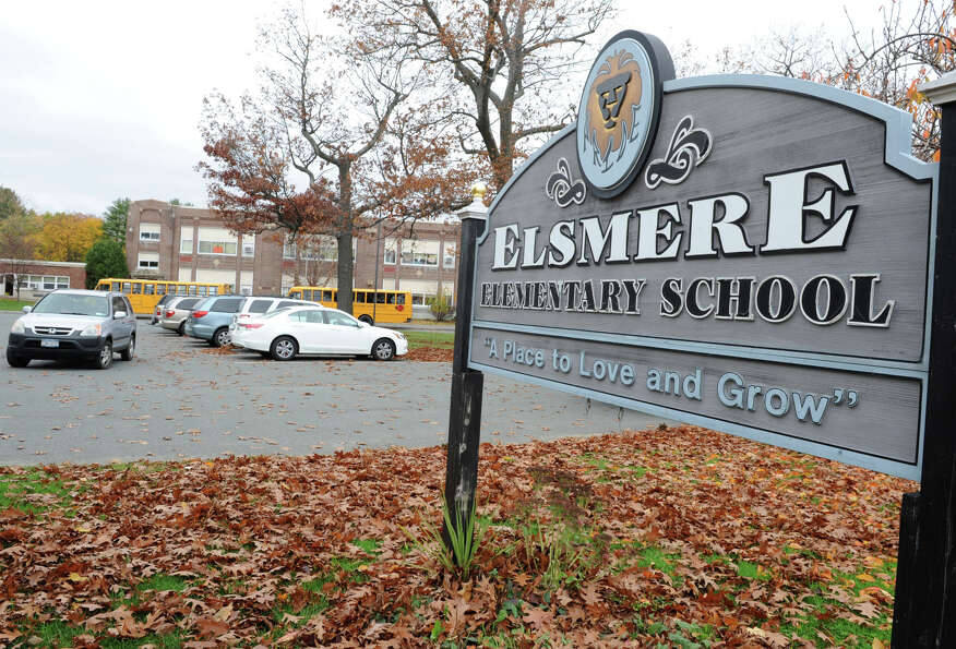 Students are let out of school early at Elsmere Elementary School due to Hurricane Sandy on Monday,