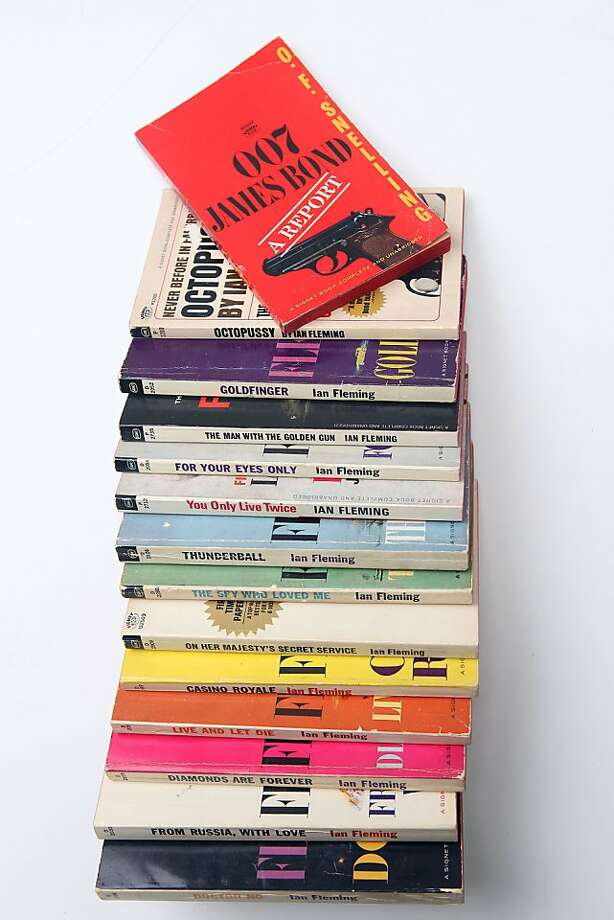 G. Allen Johnson's collection of vintage James Bond books. The spy in the novels was rougher than his on-screen counterpart. Photo: Liz Hafalia, The Chronicle