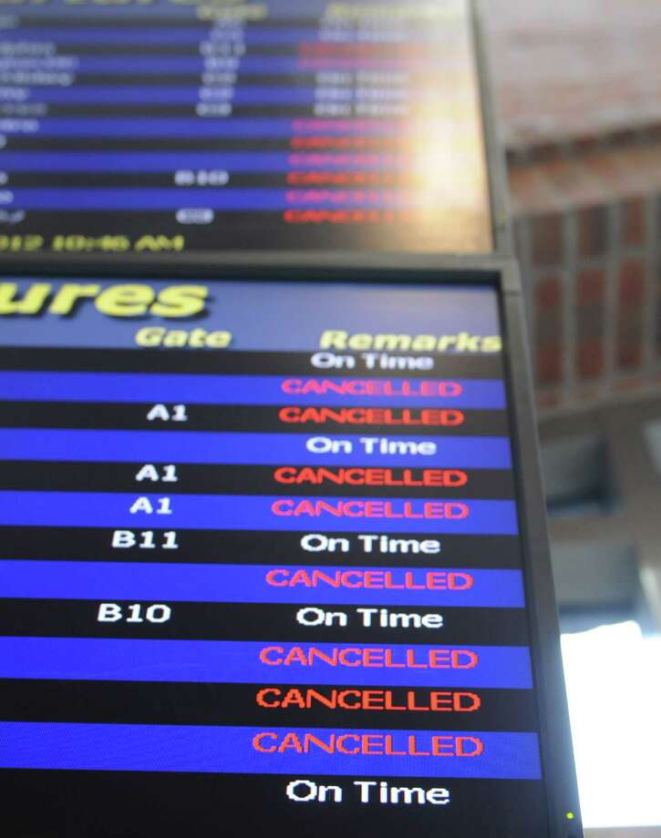 Canceled  tags littered the flight board at Albany International Airport, Monday morning, Oct. 29, 2012. Many flights in the northeast were canceled because of Hurricane Sandy. (Will Waldron / Times Union) Photo: Ww