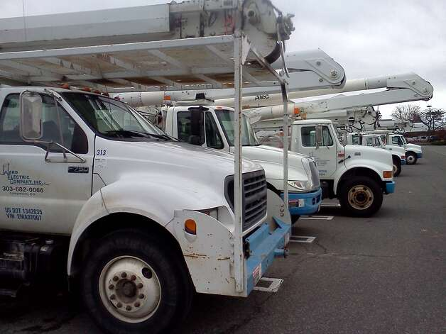 Ten bucket trucks from Ward Electric Co. of Longmont, Colo., are parked Monday at Colonie Center. The company and its crews were brought in by National Grid for Hurricane Sandy, just one of many contractors that will aid in restoration efforts expected to be needed in the coming days. The crews are being put up by Grid at the Desmond. (Larry Rulison/Times Union)