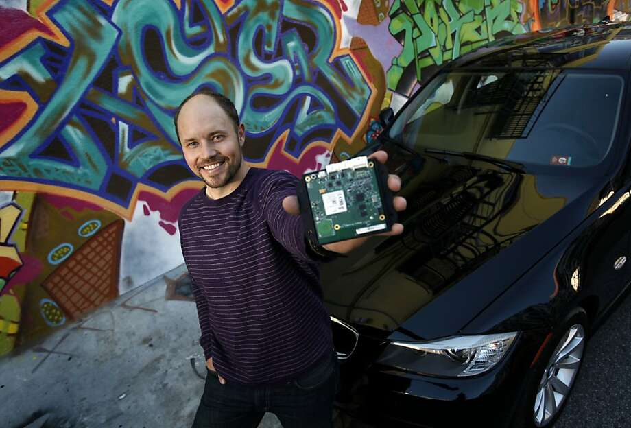 Wheelz founder Jeff Miller shows off the DriveBox, which is installed in members' vehicles to allow keyless entry. Photo: Sarah Rice, Special To The Chronicle