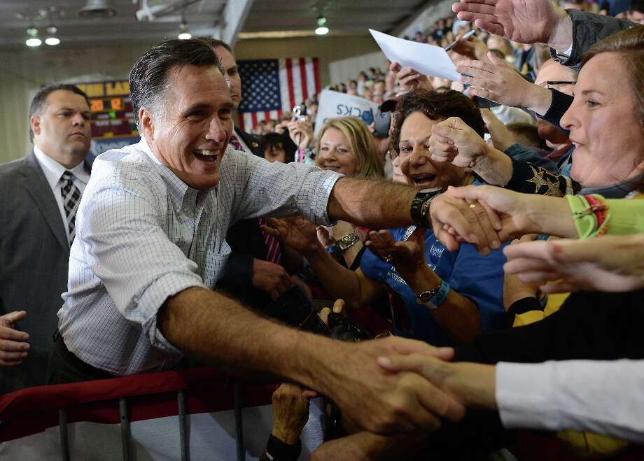 US Republican presidential candidate Mitt Romney greets supporters during a campaign rally at Avon Lake High School in Avon Lake, Ohio, on October 29, 2012. Photo: EMMANUEL DUNAND, AFP/Getty Images / AFP