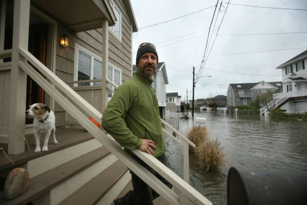 Jeff Collins surveys the flooding from Hurricane Sandy from the front steps of his home on Point Beach Drive in Milford on Monday, October 29, 2012. Photo: Brian A. Pounds