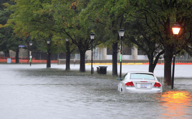 A stranded car sits parked along a street near downtown Norfolk, Va., Monday, Oct. 29, 2012. Rain and wind from Hurricane Sandy are hitting the area. Photo: AP