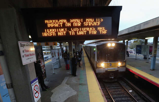 With Hurricane Sandy approaching, the Long Island Railroad announced the suspension of their service at 7pm on Sunday night, October 28, 2012 in Hicksville, New York. Sandy, which has already claimed over 50 lives in the Caribbean is predicted to bring heavy winds and floodwaters as the mid-atlantic region prepares for the damage. Photo: Bruce Bennett, Getty Images / 2012 Getty Images