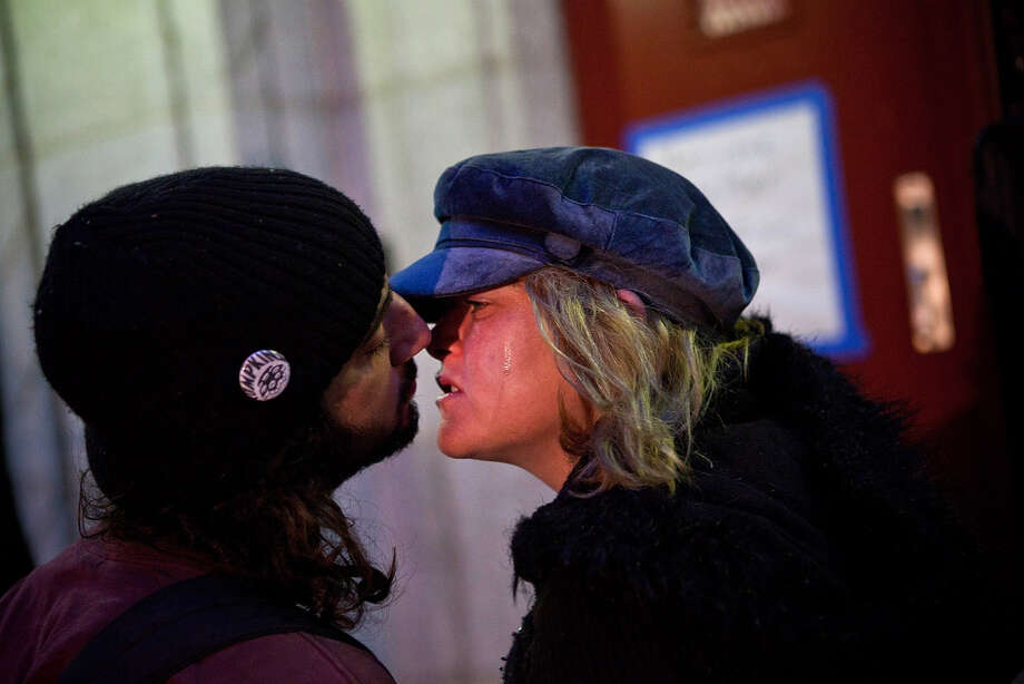 Mark Clemente and Mary McSweeney kiss before going back inside Seward Park High School, which is doubling as a hurricane evacuation center, prior to the arrival of Hurricane Sandy, on October 28, 2012 in New York City. Sandy, which has already claimed over 50 lives in the Caribbean, is predicted to bring heavy winds and floodwaters as the mid-atlantic region prepares for the damage. Photo: Andrew Burton, Getty Images / 2012 Getty Images