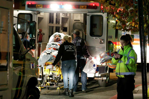 A Hoboken University Medical Center patient is transported into an ambulance during a mandatory evacuation of all ground floor units in anticipation of incoming Hurricane Sandy, Sunday, Oct. 28, 2012, in Hoboken, N.J. Tens of thousands of people were ordered to evacuate coastal areas Sunday as big cities and small towns across the U.S. Northeast braced for the onslaught of a superstorm threatening some 60 million people along the most heavily populated corridor in the nation. Photo: AP