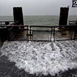 Waves wash over the sea wall near high tide at Battery Park in New York, Monday, Oct. 29, 2012 as Hurricane Sandy approaches the East Coast. Hurricane Sandy continued on its path Monday, forcing the shutdown of mass transit, schools and financial markets, sending coastal residents fleeing, and threatening a dangerous mix of high winds and soaking rain.